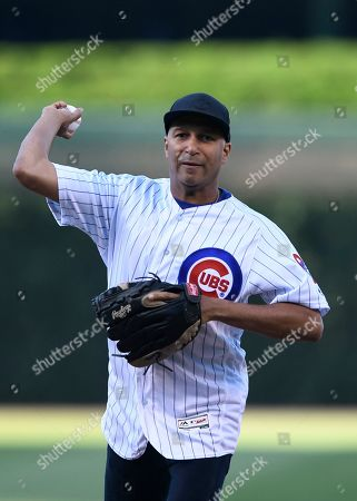 Musician Tom Morello of the band Rage Against The Machine throws out the ceremonial first pitch before a baseball game between the Chicago Cubs and Chicago White Sox Tuesday June, 18, 2019 at Wrigley Field in Chicago