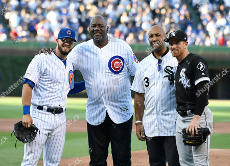 Former Chicago Cubs player Lee Smith second from left, poses with former Chicago White Sox player Harold Baines second from right, Cubs player David Bote Left, and Chicago White Sox player Charlie Tilson right, after Smith and Baines threw out the ceremonial first pitch before a baseball game between the Chicago Cubs and Chicago White Sox, at Wrigley Field in Chicago