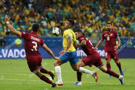 Stock Picture of Brazil's Gabriel Jesus, center, controls the ball as Venezuela's Yordan Osorio, left, and Junior Moreno challenge him during a Copa America Group A soccer match at the Arena Fonte Nova in Salvador, Brazil