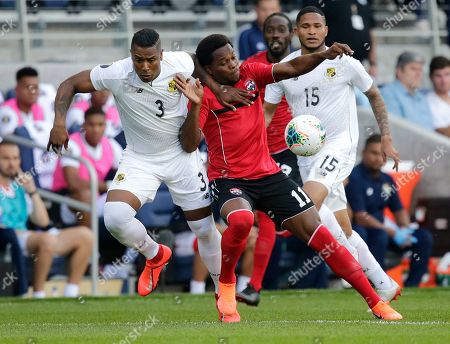 Trinidad and Tobago's Levi Garcia (11) battles for the ball with Panama's Harold Cummings (3) during the first half of a CONCACAF Gold Cup soccer game in St. Paul, Minn