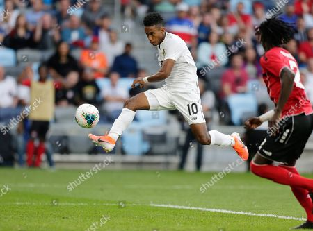 Panama's Edgar Barcenas (10) kicks a goal in front of Trinidad and Tobago's Aubrey David (2) during the second half of a CONCACAF Gold Cup soccer game in St. Paul, Minn