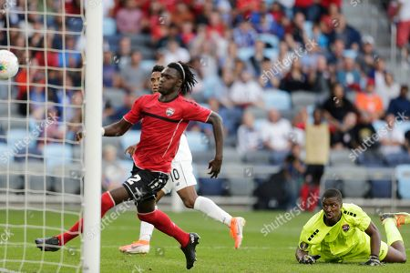 Panama's Edgar Barcenas (10) kicks a goal in front of Trinidad and Tobago's Aubrey David (2) and Trinidad and Tobago goalie Marvin Philips during the second half of a CONCACAF Gold Cup soccer game in St. Paul, Minn