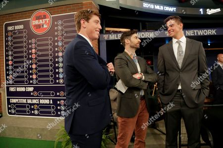 Personality Scott Rogowsky, center, talks to prospects Brett Baty, left, a third baseman from Lake Travis High School in Austin, Texas, and Jackson Rutledge, a right handed pitcher from San Jacinto Junior College, in Pasadena, Texas, prior to the first round of the Major League Baseball draft, in Secaucus, N.J