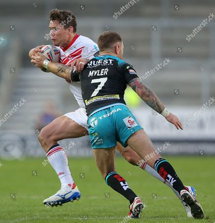 Louie McCarthy-Scarsbrook of St Helens tries to outrun Richie Myler of Leeds Rhinos and Adam Cuthbertson of Leeds Rhinos