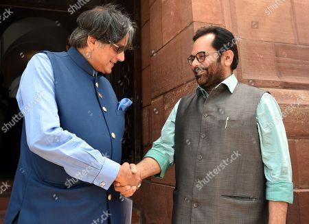 Minister of Minority Affairs Mukhtar Abbas Naqvi greets Congress MP from Thiruvananthapuram Shashi Tharoor