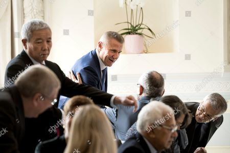 IOC member Sergei Bubka from Ukraine (C) talks with other IOC memebrs prior to the opening of the International Olympic Committee (IOC) executive board meeting in Lausanne, Switzerland, 19 June 2019.