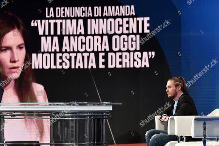Raffaele Sollecito, on background a picture of Amanda Knox