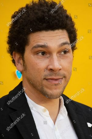 Joel Fry poses for photographers upon arrival at the premiere of the film 'Yesterday' in London