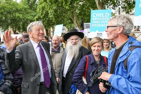 Lord Dubs (L) and campaigners from Safe Passage and recently arrived young refugees demonstrate in Parliament Square, calling on the Government to welcome 10,000 child refugees. Lord Dubs arrived in the UK on the Kindertransport as a child refugee, along with nearly 10,000 predominantly Jewish children who were fleeing Nazi controlled Europe.