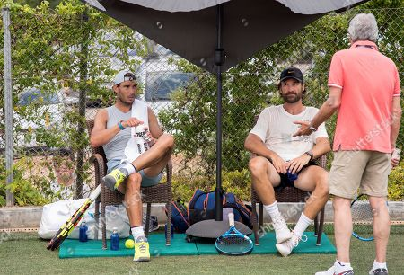Spanish tennis player Rafa Nadal (L) rests next to his coach Carlos Moya during a training session at the Country Club in Santa Posa, Mallorca, Spain, 19 June 2019. Nadal is preparing for the Wimbledon tournament at the club where the women's Mallorca Open is taking place from 16 to 23 June 2019.
