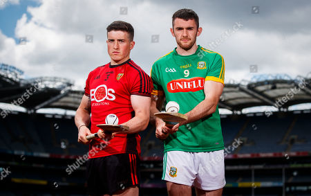 Down's Caolan Taggart with Sean Geraghty of Meath