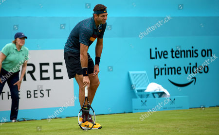 Stock Photo of Juan Martin del Potro of Argentina feels pain in his knee