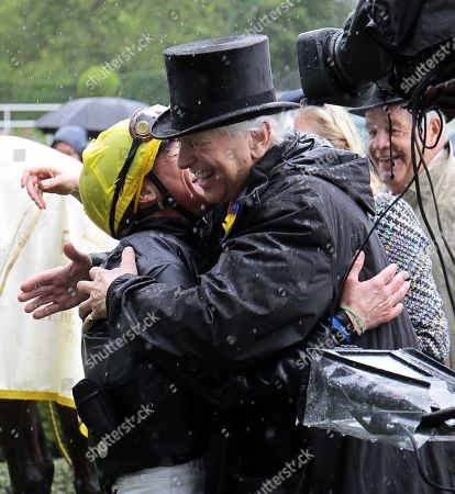 Stock Image of Frankie Dettori is congratulated by Sir Evelyn De Rothschild after Crystal Ocean had won the Prince Of Wales's Stakes at Royal Ascot.