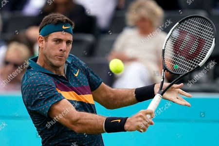 Argentina's Juan Martin del Potro serves to Canada's Denis Shapovalov during their round 32 match at the Fever Tree Championship at Queen's Club in London, Britain, 19 June 2019. The tournament runs from 17th June till 23 June 2019.
