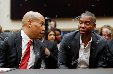 Cory Booker, Ta-Nehisi. Democratic Presidential candidate Sen. Cory Booker, D-N.J., left, talks with author Ta-Nehisi Coates, right, as he waits to testify about reparation for the descendants of slaves during a hearing before the House Judiciary Subcommittee on the Constitution, Civil Rights and Civil Liberties, at the Capitol in Washington