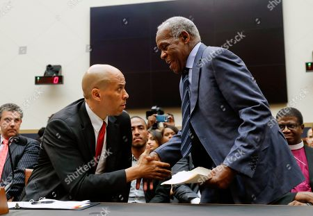 Cory Booker, Danny Glover. Democratic Presidential candidate Sen. Cory Booker, D-NJ, left, greets Actor Danny Glover, before they testify about reparations for the descendants of slaves, during a hearing before the House Judiciary Subcommittee on the Constitution, Civil Rights and Civil Liberties, at the Capitol in Washington