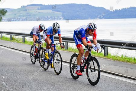 (R-L) Stefan Kueng from Switzerland of Groupama-FDJ, Fabien Grellier from France of Total Direct Energie, and Matej Mohoric from Slovenia of Bahrain-Merida Pro Cycling Team pass the Zugersee in the breakaway during the fifth stage of the 83rd Tour de Suisse UCI ProTour cycling race, over 177 km from Muenchenstein to Einsiedeln, Switzerland, 19 June 2019.