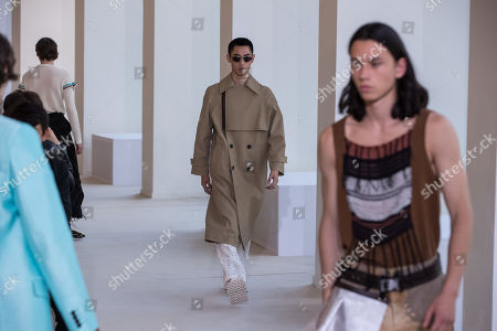 Models present creations by Swedish designer Jonny Johansson for Acne Studios fashion house during the Paris Fashion Week, in Paris, France, 19 June 2019. The presentation of the Spring/Summer 2020 menswear collections runs from 18 to 23 June.