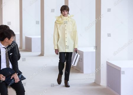 Stock Picture of A model presents a creation by Swedish designer Jonny Johansson for Acne Studios fashion house during the Paris Fashion Week, in Paris, France, 19 June 2019. The presentation of the Spring/Summer 2020 menswear collections runs from 18 to 23 June.