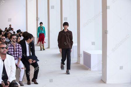 Stock Photo of A model presents a creation by Swedish designer Jonny Johansson for Acne Studios fashion house during the Paris Fashion Week, in Paris, France, 19 June 2019. The presentation of the Spring/Summer 2020 menswear collections runs from 18 to 23 June.