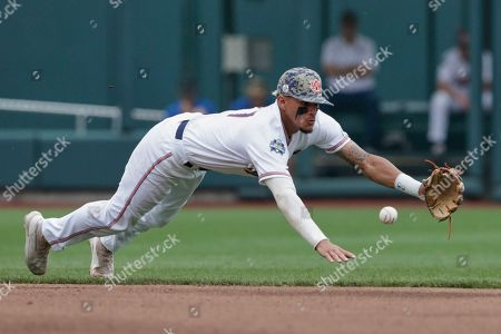 Stock Photo of Will Holland, Lucas Dunn. Auburn shortstop Will Holland (17) can't catch a ball hit by Louisville's Lucas Dunn for a base hit in the seventh inning of an NCAA College World Series baseball game in Omaha, Neb