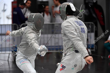 Stock Photo of Csanad Gemesi of Hungary (L) and William Deary of Great Britain in action during the men's sabre competition, round of 64, of the 2019 Fencing European Championships in Duesseldorf, Germany, 19 June 2019.