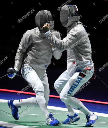 Aron Szilagyi of Hungary (L) and Aldo Montano of Italy in action during the men's sabre competition, round of 32, of the 2019 Fencing European Championships in Duesseldorf, Germany, 19 June 2019.