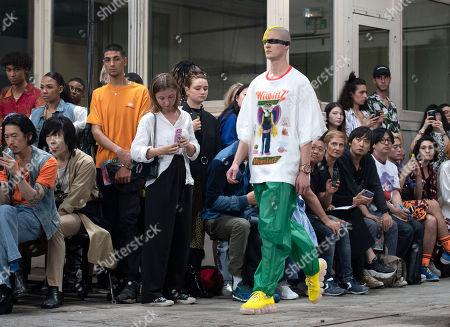 Stock Photo of A model presents creations by Belgian designer Walter van Beirendonck during the Paris Fashion Week, in Paris, France, 19 June 2019. The presentation of the Spring/Summer 2020 menswear collections runs from 18 to 23 June.