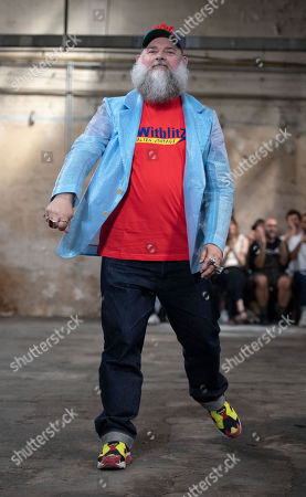 Belgian designer Walter van Beirendonck greets the audience after presenting his collection during the Paris Fashion Week, in Paris, France, 19 June 2019. The presentation of the Spring/Summer 2020 menswear collections runs from 18 to 23 June.