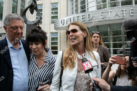 Stock Photo of Toni Natalie, second from left, and Catherine Oxenberg talk with the media outside Brooklyn federal court after NXIVM defendant Keith Raniere was found guilty on all counts, in New York. Natalie is a former member of NXIVM and Oxenberg's daughter was a member of NXIVM