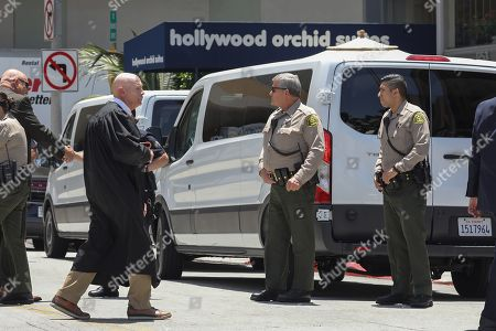 Judge Larry Fidler walks near vans carrying jury members as they visit an evidence site located at 1759 Orchard Avenue during the murder trial of Michael Gargiulo in Los Angeles, California, USA, 19 June 2019. Gargiulo is charged in the stabbing deaths of two women, one of whom was about to go out with actor Ashton Kutcher that night, as well as attempting to kill a woman during a robbery at her Santa Monica home.