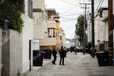 Police officers stand guard next to an evidence site visited by the jury members located at 1229 12th Street in Santa Monica during the murder trial of Michael Gargiulo in Los Angeles, California, USA, 19 June 2019. Gargiulo is charged in the stabbing deaths of two women, one of whom was about to go out with actor Ashton Kutcher that night, as well as attempting to kill a woman during a robbery at her Santa Monica home.