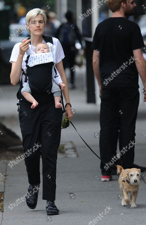 Agyness Deyn and her child walk their dog