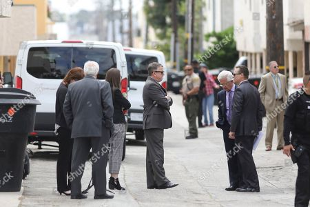 Attorneys and law enforcement officers stand in an alley while jury members visit an evidence site located in Santa Monica during the murder trial of Michael Gargiulo in Los Angeles, Calif., on . Gargiulo is charged in the stabbing deaths of two women, one of whom was about to go out with actor Ashton Kutcher that night, as well as attempting to kill a woman during a robbery at her Santa Monica home