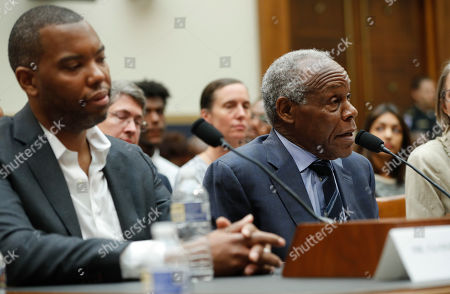 Actor Danny Glover, right, and author Ta-Nehisi Coates, left, testify about reparation for the descendants of slaves during a hearing before the House Judiciary Subcommittee on the Constitution, Civil Rights and Civil Liberties, at the Capitol in Washington