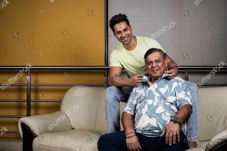 Stock Photo of David Dhawan with his son Varun Dhawan