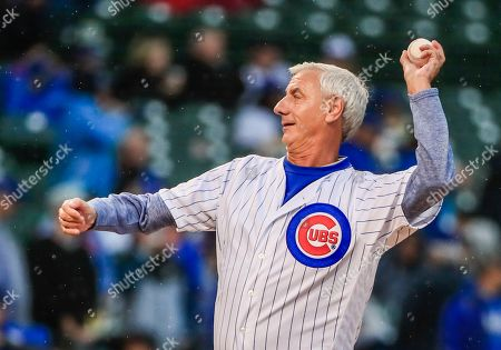 Former Liverpool soccer star Ian Rush throws out a ceremonial first pitch before the start of of the MLB game between the Chicago White Sox and the Chicago Cubs at Wrigley Field in Chicago, Illinois, USA, 19 June 2019.