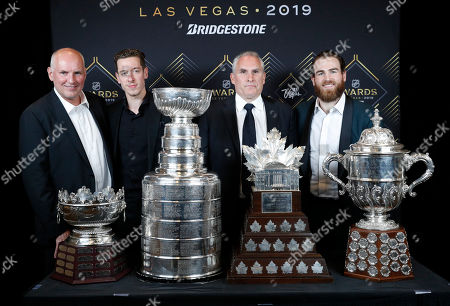 Stock Image of From left, St. Louis Blues general manager Doug Armstrong, goalie Jordan Binnington, interim coach Craig Berube and center Ryan O'Reilly pose at the NHL Awards, in Las Vegas