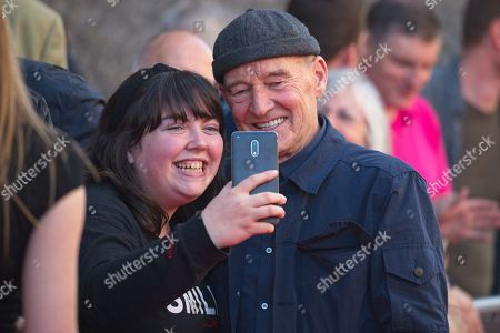 David Hayman posing for a selfie with fans