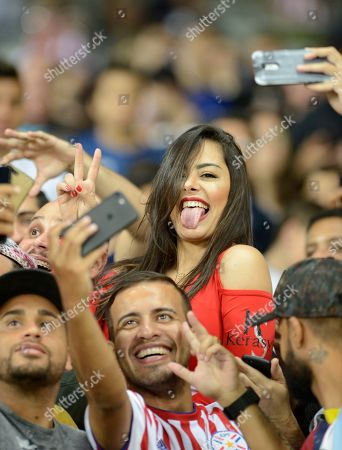Paraguay's soccer fan Larissa Riquelme poses for photos during a Copa America Group B soccer match at the Mineirao stadium in Belo Horizonte, Brazil