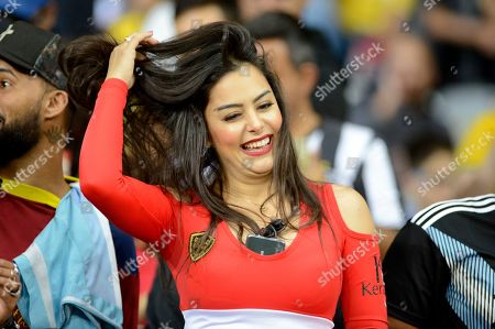 Stock Photo of Paraguay's soccer fan Larissa Riquelme smiles during a Copa America Group B soccer match between Paraguay and Argentina at the Mineirao stadium in Belo Horizonte, Brazil