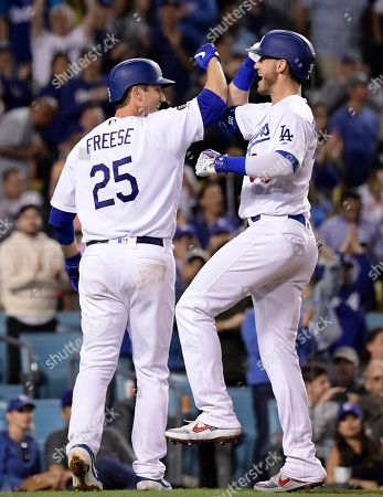 Cody Bellinger, David Freese. Los Angeles Dodgers' Cody Bellinger, right, is congratulated by David Freese after hitting a two-run home run during the seventh inning of a baseball game against the San Francisco Giants, in Los Angeles