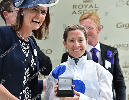 Major Heather Stanning, Olympic Gold winning rower, presents a trophy for The Sandringham Stakes to winning jockey, Hayley Turner..