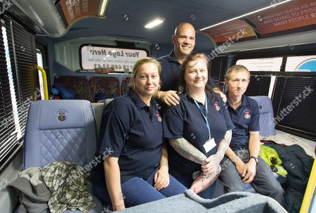 Stock Image of The Ark Project A Homeless Charity Helping The Homeless By Offering Them A Bed The Bus Can Sleep Ten High Street Windsor. Pictured ( L-r) - Victoria Dowling Michael Longsmith(back) Sarah Willmott And Aaron Johnson.
