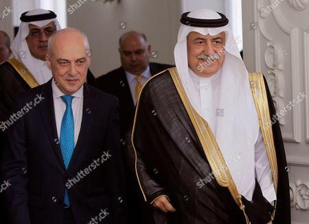 Saudi Arabia's Foreign Minister Adel Al-Jubeir, right, and Georgian Foreign Minister David Zalkaliani enter a hall for their talks in Tbilisi, Georgia