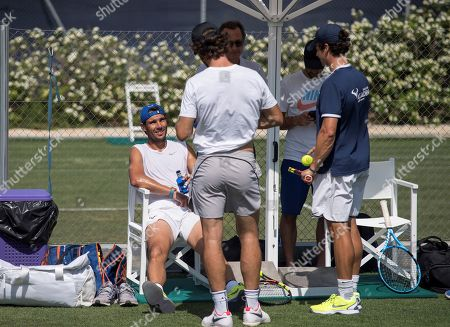 Spanish tennis player Rafa Nadal (L) chats with his coach, Carlos Moya (2-L), as he attends a training session at Country Club in Santa Ponsa, Majorca, Spain, 20 June 2019. Nadal prepares for the upcoming Wimbledon Championships.