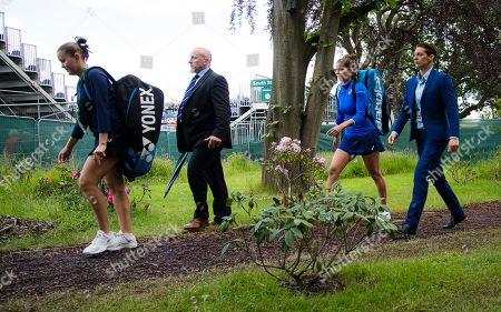 Evgeniya Rodina of Russia & Julia Goerges of Germany on their way to court for their second-round match