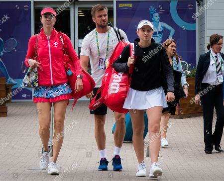 Stock Picture of Galina Voskoboeva of Kazakhstan and Jelena Ostapenko of Latvia on their way to the court for their doubles match