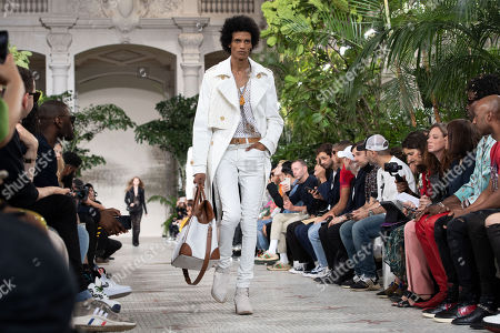 A model presents a creation from the Spring/Summer 2020 Men's collection by US designer Mike Amiri for his label Amiri during the Paris Fashion Week, in Paris, France, 20 June 2019. The presentation of the Spring/Summer 2020 menswear collections runs from 18 to 23 June 2019.