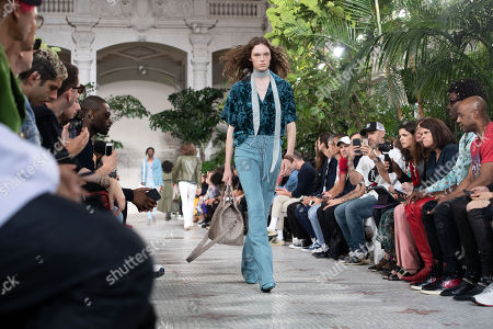Stock Picture of Models present creations from the Spring/Summer 2020 Men's collection by US designer Mike Amiri for his label Amiri during the Paris Fashion Week, in Paris, France, 20 June 2019. The presentation of the Spring/Summer 2020 menswear collections runs from 18 to 23 June 2019.